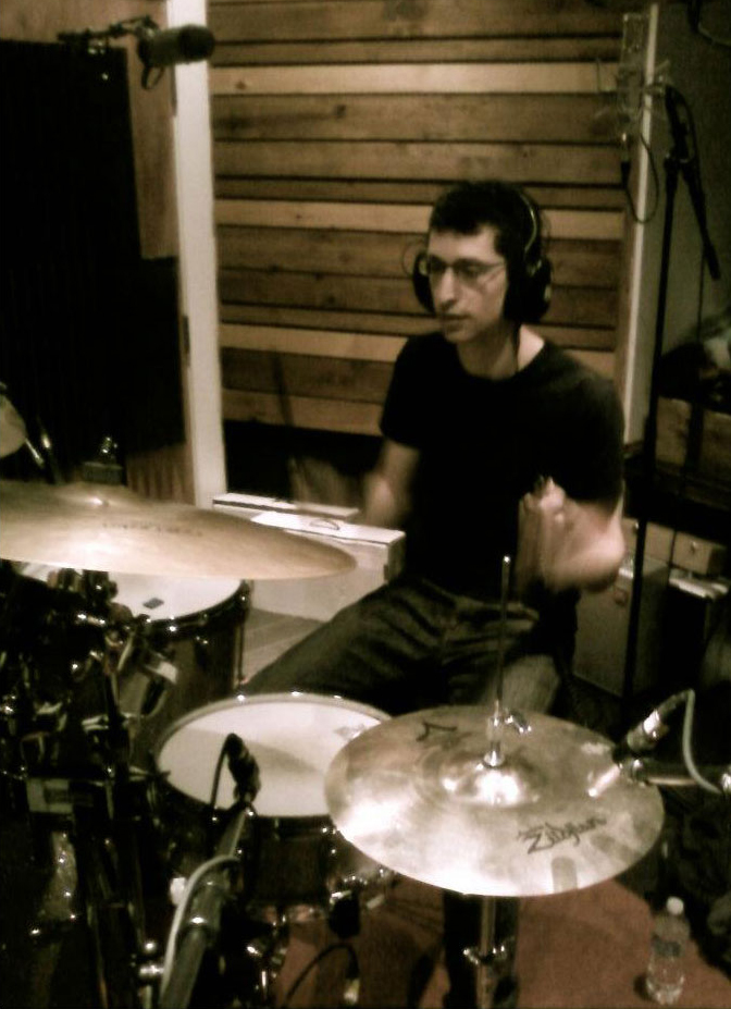 Alexander Nathan playing drums in the studio