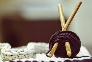 Crochet needles and a ball of yarn