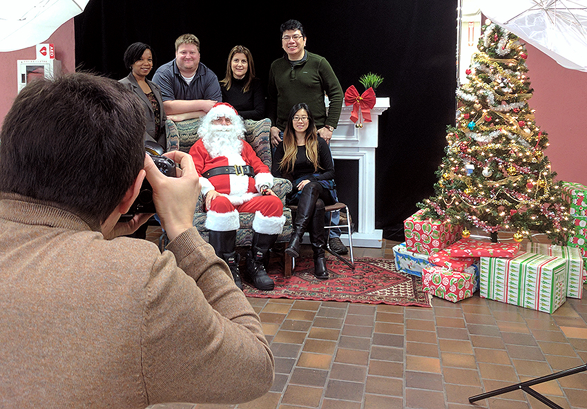 University of Toronto Mississauga (UTM) staff taking photos with Santa for the United Way