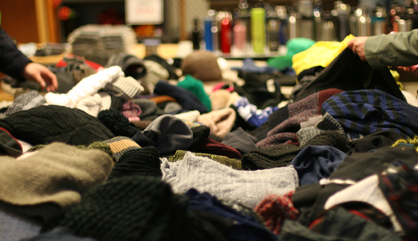 Closeup of second-hand clothes on large table at the Annual Swap Shop Sale in support of the United Way