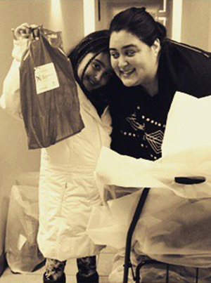 Kim's partner Flor, with daughter delivering care packages over the holidays