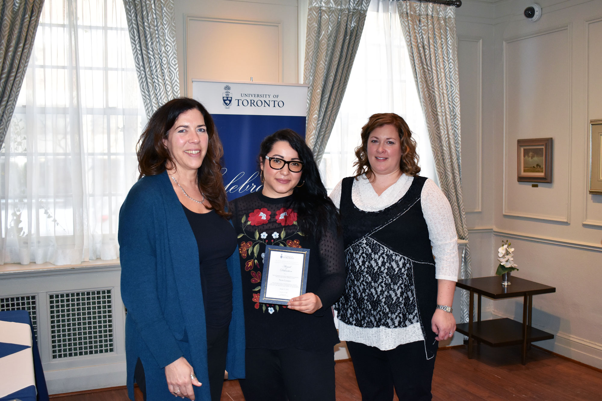 Nora Lozano poses with their HRE award of distinction with VP Kelly Hannah-Moffat and CHRO Erin Jackson